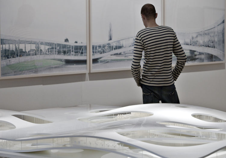 The exhibition features models of Sanaa's works--such as this one depicting the firm's recently completed Rolex Learning Center in Lausanne, Switzerland as an extension to the École Polytechnique Fédérale de Lausanne--as well as photographs of Sanaa's wor