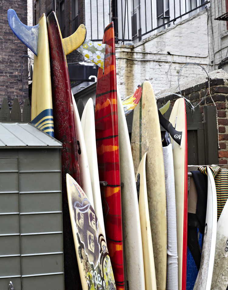 The shop owners' personal collection of surfboards occupies a corner of the patio.