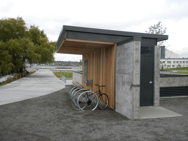 One detail at the park that did catch my eye was the bike rack. The simple design houses the bicycle parking and a water fountain on one side and a raised garden on the back.