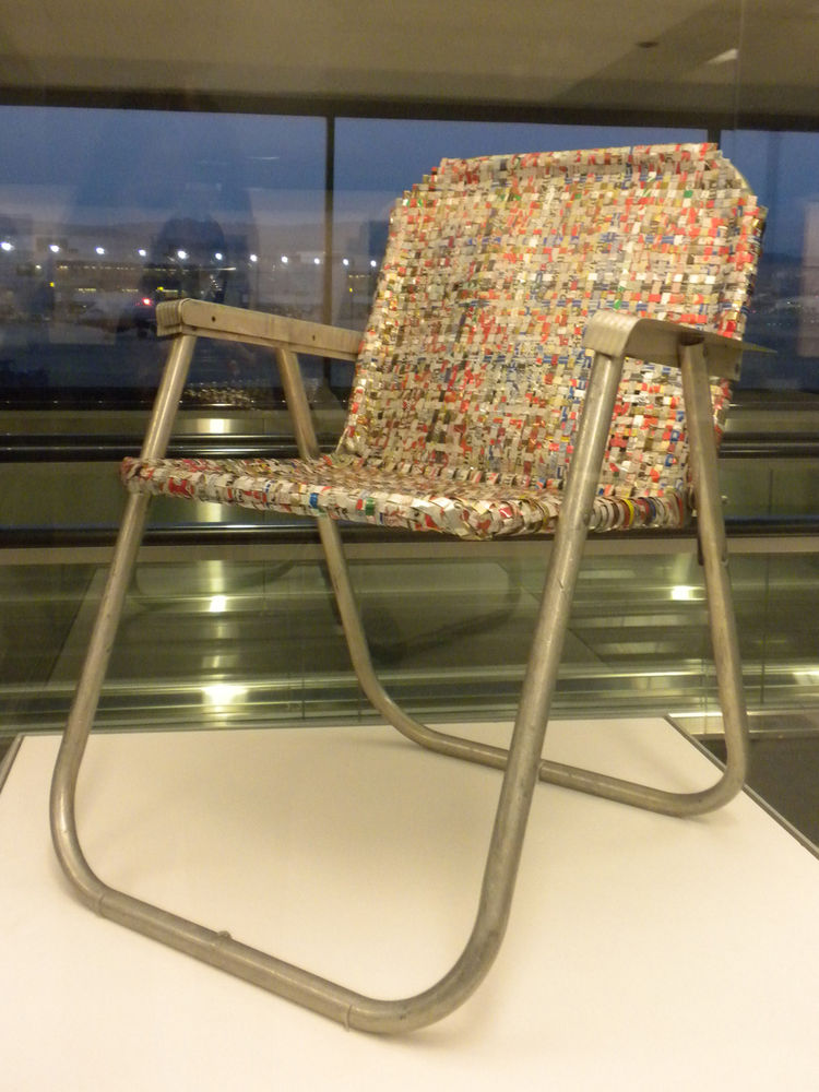 """Writer, inventor, and environmentalist Svein """"Slim"""" Sirnes created a tool to cut aluminum cans into strips then proceeded to create sculptures, clothing, purses, lamps, and furniture with the recycled metal. In the early 1990s he created this lawn chair w"""
