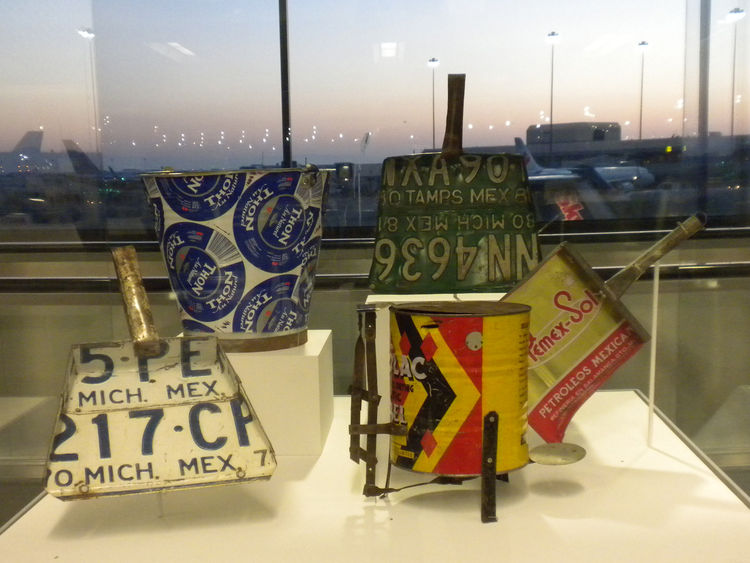 Whereas in the United States we often use old license plates to decorate bars and grills, in many towns in Africa, India, and Latin America, these sturdy pieces of metal are repurposed into household goods, such as dustpans. Shown here are examples of tho