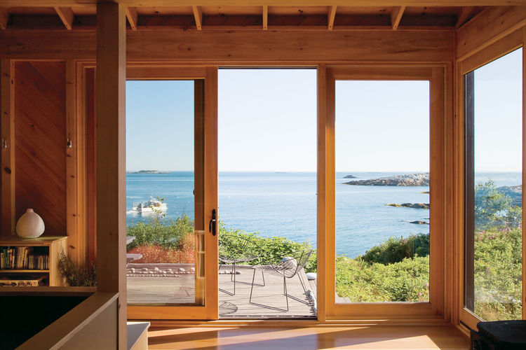 "The porch at writer <a href=""http://www.dwell.com/slideshows/worth-the-wait-otg.html"">Bruce Porter's off-the-grid retreat</a> on Ragged Island, Maine, boasts Leaf chairs by Arper as well as dreamy views."