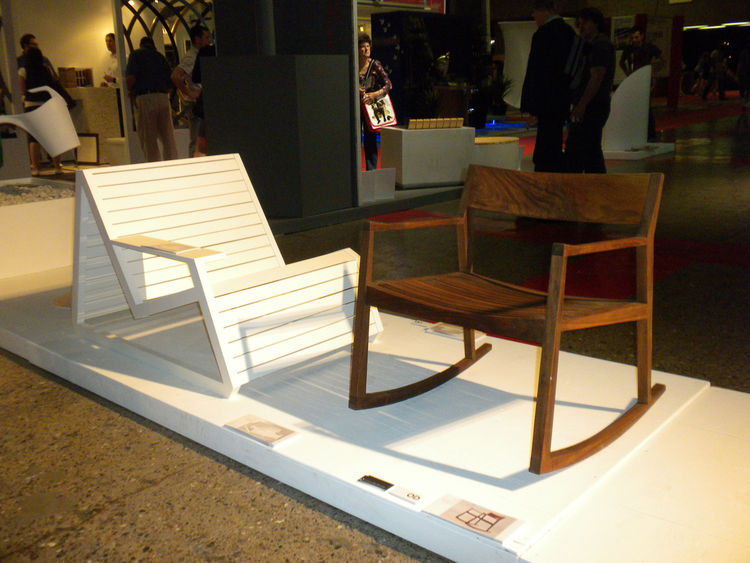 "Olivier DesRochers' <i>SouthBeach</i> (left, made of pine) and <i>Ronron</i> (right, made of black walnut) chairs for his company <a href=""http://www.od-design.com/""OD</a> stood out among the furniture on display. While the SouthBeach was a modern verison"