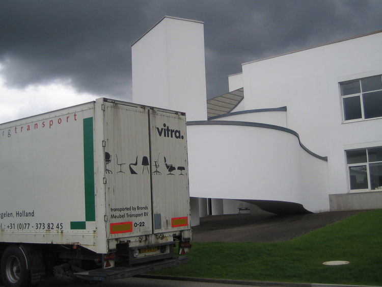 I loved this image of another of Gehry's buildings on campus playing backdrop to a Vitra delivery truck. The darkening sky gives the whole affair a rather ominous look.