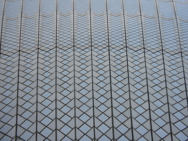 The most surprising things to me were that the sails are (1) not pure white, as many photos depict them, and (2) are made up of more than one million ceramic tiles from Sweden. This detail shot shows the cream and off-white tiles, which our tour guide sai