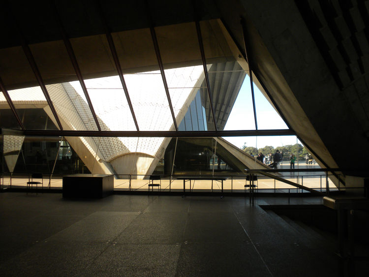 This photo shows the view from the Concert Hall foyer toward the Opera Hall through the glass windows. After Utzon was dismissed as chief architect, he never returned to Sydney and never saw the completed Opera House. In 1999, however, he worked on the bu