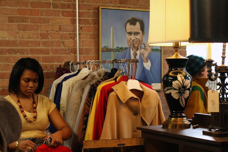 "TVB is a-ok! A goofy portrait of President Nixon from Manly Vintage's booth keeps an eye on Jillian Knox of <a href=""http://joulesjewels.etsy.com"">JJoules Vintage</a> as she stocks a rack with fab vintage coats. <br /><br />Photo by <a href=""http://twitte"