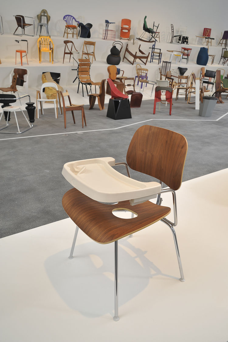 The design team comprising Tom Reynolds, Tim Peet, Jared Delorenzo, Alie Thomer, Alexandra Powell, and Andrew McCandlish modded a classic Eames chair to create a highchair, complete with tray and leg holes.