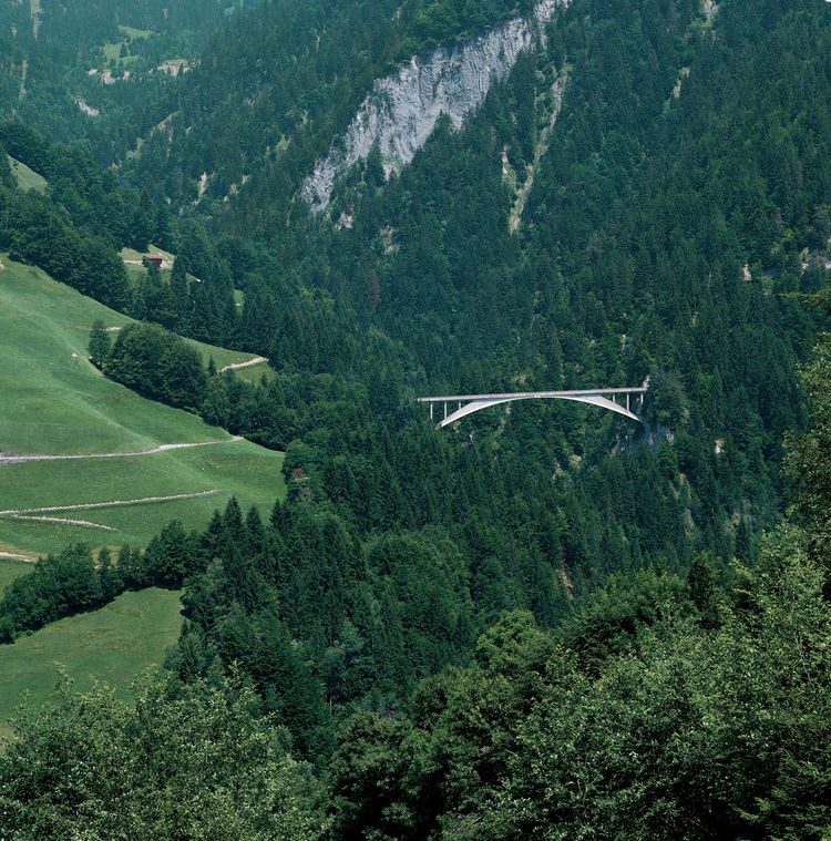 Finally, the show features the structural spans of Swiss bridge designers Robert Maillart and Christian Menn. Shown here is Maillart's Salginatobel Bridge, built in the Salgina Valley in Schiers, Switzerland in 1930. Photo by Mancia/Bodmer FBM Studio.