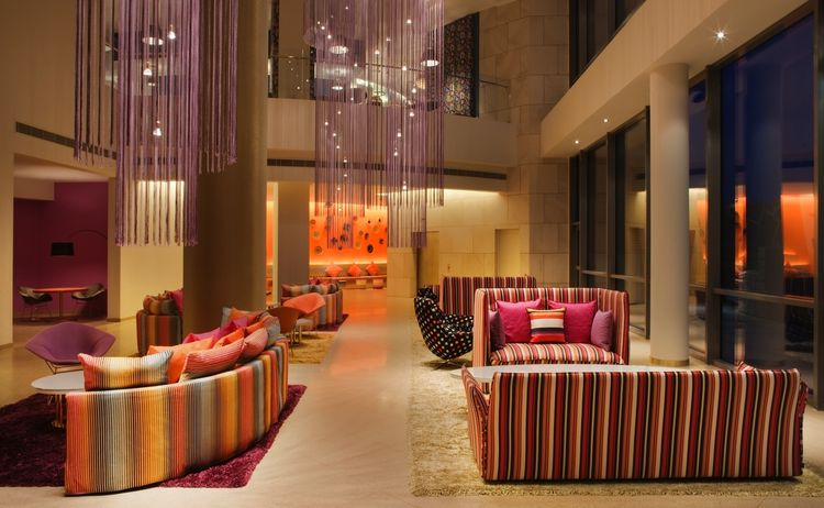"The design and colors of the hotel are inspired by the destination—a graceful melding of Missoni and Kuwait's aesthetic. The Arabian Sea is reflected by the cool turquoise, bold fuschia, and gleaming golds in the hotel lobby. Photo by <a href=""http://www."