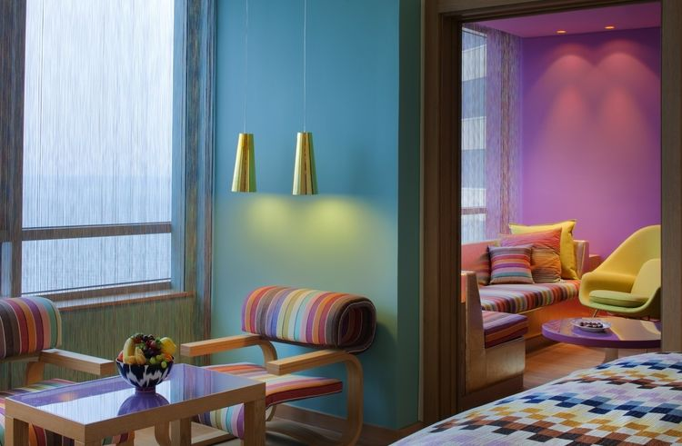 The rooms are awash in Missoni's signature prints, with modern furniture by the likes of Arne Jacobsen, Jeffrey Bernett, and Pierre Paulin. The bedrooms, all of which face the sea, feature customized Missoni textiles produced specially for the resort. Pho
