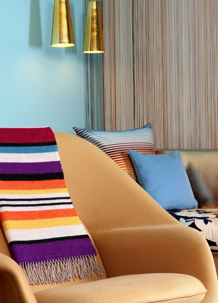 """Eero Saarinen's Womb chairs are proudly used in the guestrooms. Missoni throws add a colorful accent in the living room. Photo by <a href=""""http://www.gerryoleary.com/"""">Gerry O'Leary</a>."""