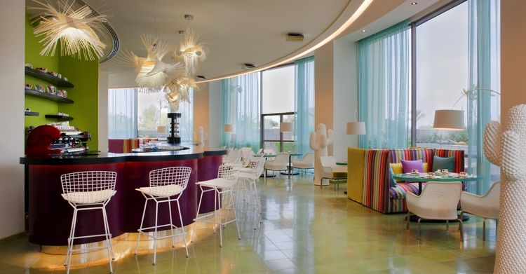 """The Choco Bar offers Kuwait a chance to sample two of the best Italian delicacies: chocolate and coffee. The white floor lamps are Marc Saddler Twiggy lamps. The barstools are Bertoia wire chairs. Photo by <a href=""""http://www.gerryoleary.com/"""">Gerry O'Lea"""