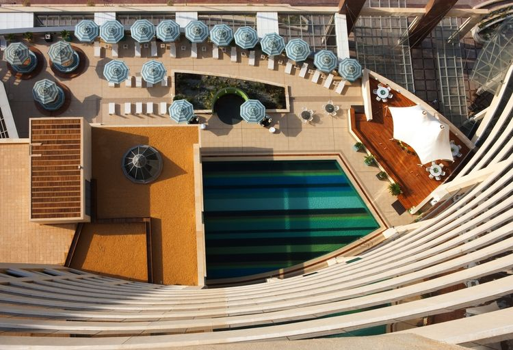 """The pool, which overlooks the Arabian Sea, was meticulously tiled with mosaics in the signature Missoni stripe pattern. Taken in total, nearly 10 million individual tiles are used in mosaics throughout the property. Photo by <a href=""""http://www.gerryolear"""