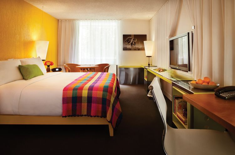 The colors used in the public spaces flow right into the guest rooms. Each of the 194 abodes is unique, but all are colored with solid hues and balanced out by monochromatic vintage photographs of Saguaro cacti. When questioned about their decision to wit