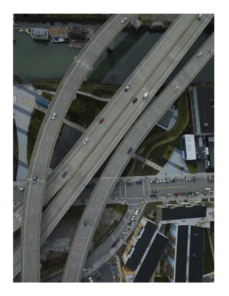 This photo is called 3rd and 6th and graphically describes a variety of forms of transits, the freeway superimposed over the waterway.