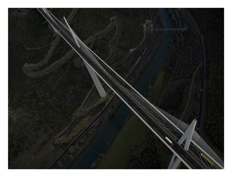 The Millau Viaduct is a cable-stayed road bridge in southern France. It's the tallest vehicular bridge in the world (taller than the Eiffel Tower) and was designed by architect Norman Foster and structural engineer Michel Virlogeux.