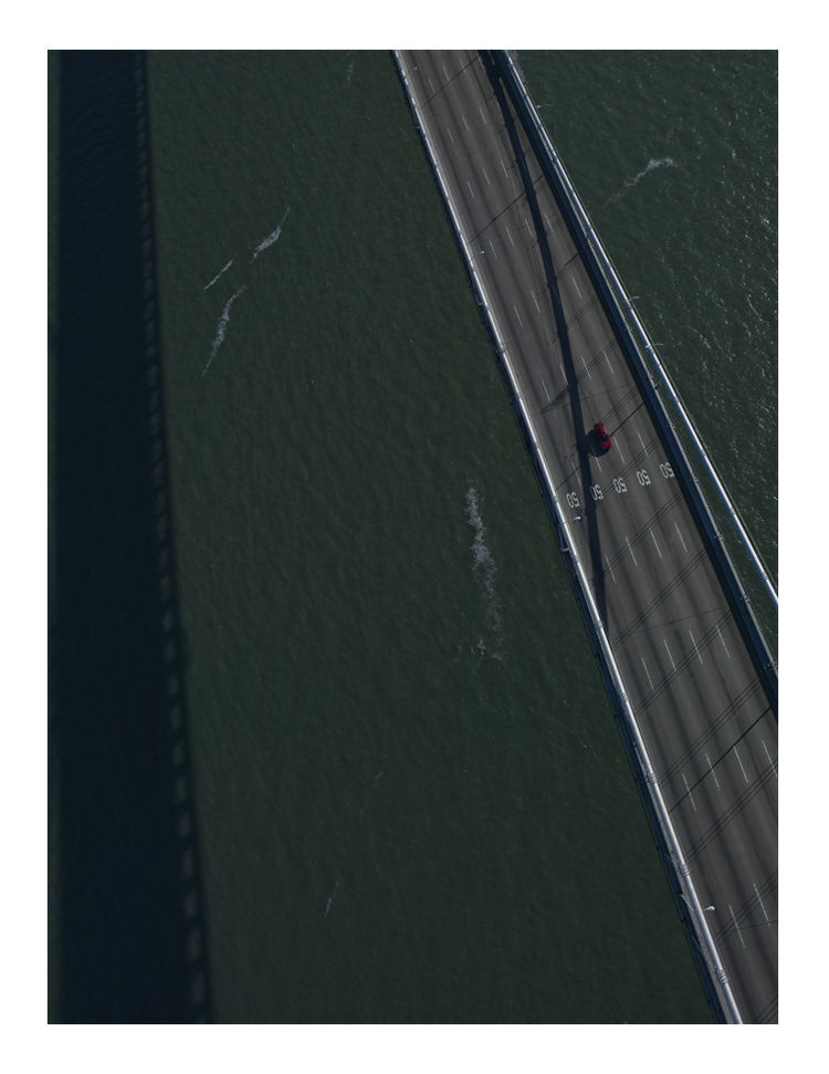 "Titled ""San Francisco,"" this aerial view of what is likely the Bay Bridge shows the kind of gritty, lonely weight our infrastructure has to pull."