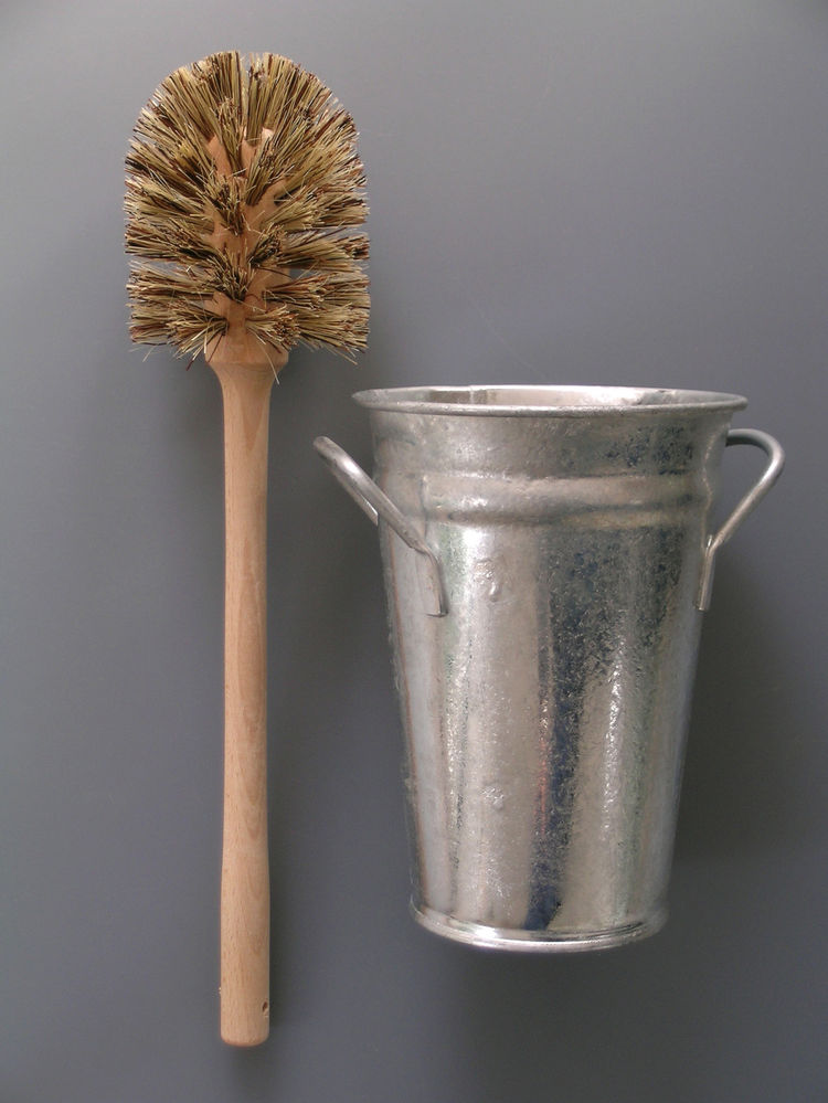 """<b>Toilet Brush and Bucket</b> """"We created this combination as it was impossible to find an attractive and functional toilet set. We like the functional look of the traditional florist's Bucket and traditional wooden brush."""" Photo courtesy of Labour and W"""