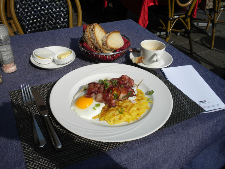 "At a restaurant across from City Hall, I enjoyed my first Swiss meal: fried eggs, bacon, and <i>rosti</i>. I was told by Diccon Bewes, a Brit turned Swiss who has lived in the country for years and recently penned the book <a href=""http://swisswatching.wo"
