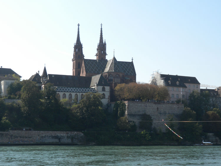 This view of the Münster is taken from the other side of the Rhine. The Romanesque and Gothic cathedral was built between 1019 and 1500 and dominates Basel's skyline.