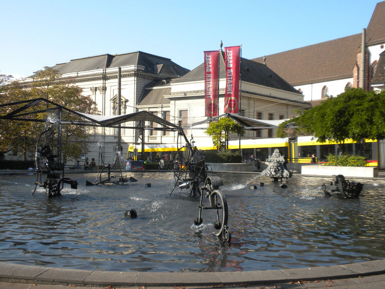 The most famous fountain in Basel is the Tinguely Fountain next to the Basel Theater. This funny fountain features a large, shallow pool with moving sculptures by Swiss artist Jean Tinguely that spit water in all directions and make sounds as the metal pa
