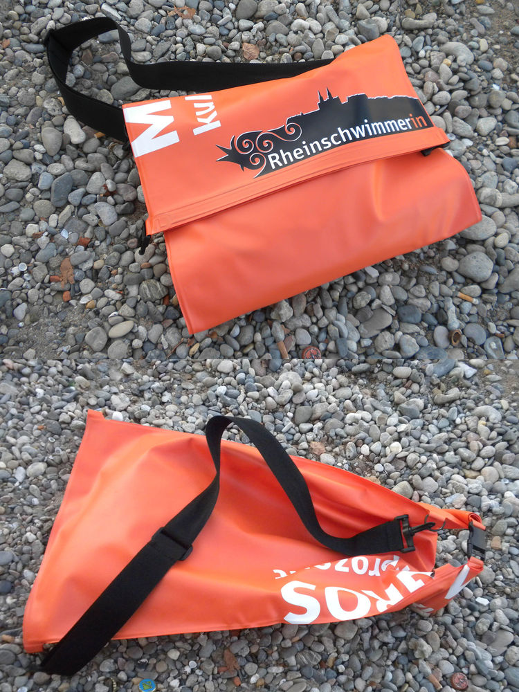When hopping in the Rhine, you have two options: Leave your things on shore and walk back to them after your swim or carry them with you in a dry bag. I picked up this dry bag from a tourist counter in a local grocery store. I loved its design because it