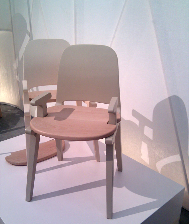 "This simple wooden chair by Brazil-born, Italian designer <a href=""http://www.antonioarico.com/"">Antonio Aricò</a> features a seat that fits onto the diminutive arms like a piece of a jigsaw puzzle."