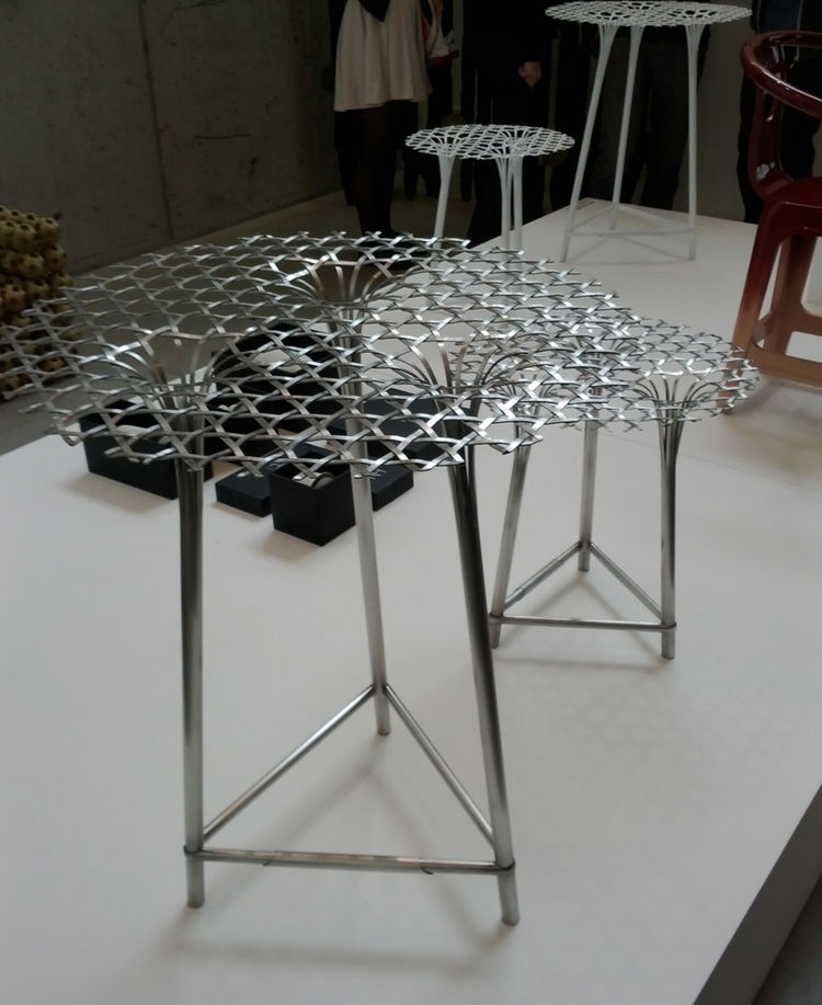 "<a href=""http://www.nendo.jp/en/"">Nendo</a> has several shows at satellite events and the fairgrounds, but these tables, which look like metal pieces for outdoor use are actually made from bamboo."