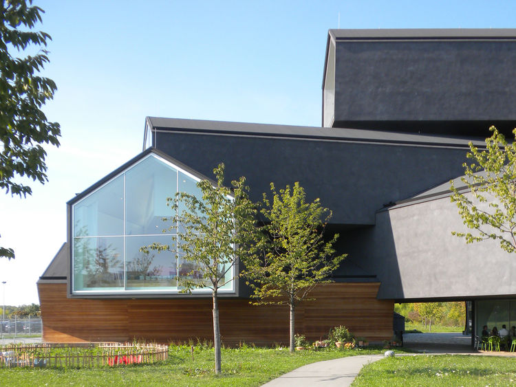 "The VitraHaus was designed by Basel-based firm <a href=""http://www.herzogdemeuron.com/index.html"">Herzog & de Meuron</a> and completed in 2010. The building is made of poured-in-place concrete, with the exterior covered in dark plaster and local fir."