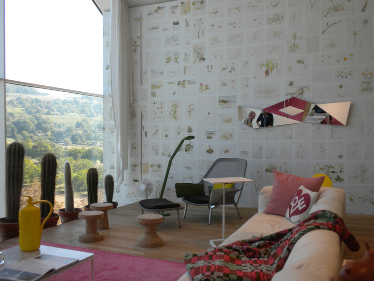 "Much of the VitraHaus is set up in vignettes, like this living room scene that features the Slow Chair and Ottoman by <a href=""http://www.dwell.com/people/the-bouroullec-brothers.html?tab=about&c=y"">Ronan and Erwan Bouroullec</a> designed in 2006, the Pla"