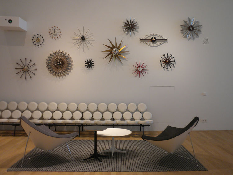 "The area dedicated to designer <a href=""http://www.dwell.com/people/george-nelson.html?tab=designs&c=y"">George Nelson</a> boasts the longest Marshmallow Sofa I've ever seen. Next to it are two of Nelson's Coconut chairs, designed in 1955, and above are an"