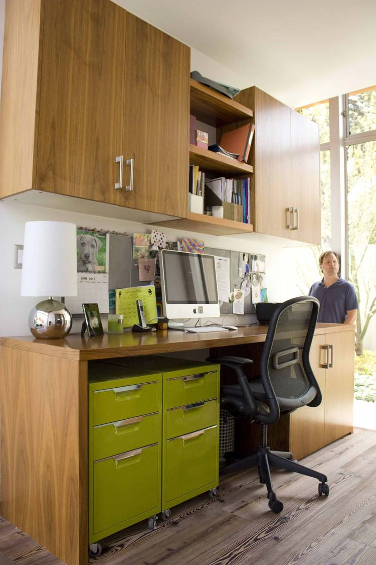 The office is hidden behind the first living area, completely removed from a visitor's field of vision. It gives the owners a private place to work, while still keeping them connected to the rest of the home. It is a clever use of space says one visitor.