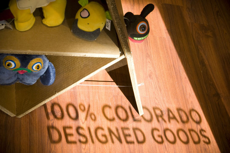 The shop features 100-percent locally designed goods from Colorado artists and designers. Corrigan tapped into another source of local talent for this shop's design, working with students at the Art Institute of Colorado in Denver to concept the store's l