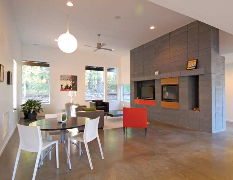 A concrete block hearth serves as the focus of the main living area as well as the delineation of the main entrance.