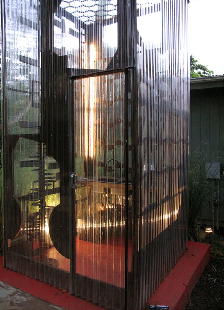 A small door lets cooks and hungry interns into the Cor-Ten steel and corrugated polycarbonate tube.