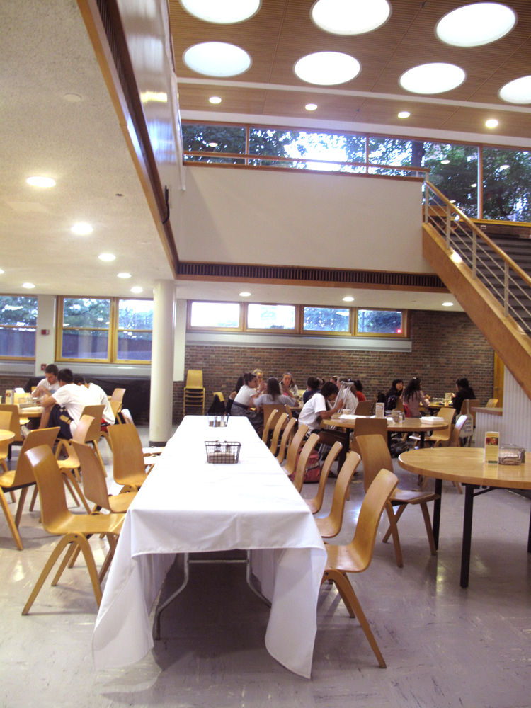 A view of the two-story dining hall and atrium. Students tend to gather in the lower level to eat, and the upper level to study.
