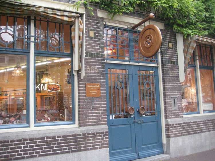 """A big wooden button marks the spot at <a href=""""http://www.knopenwinkel.net/"""">Knopenwinkel</a> (note the door handles, too!), a shop stocking more of the little accoutrement than I've ever seen in one place."""