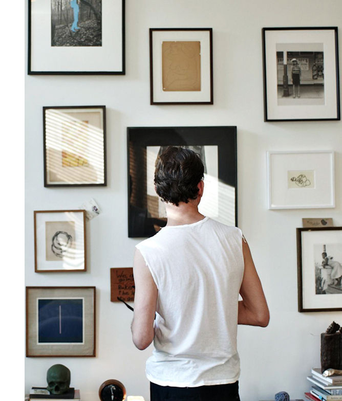 Art and images on the wall of stylist Scott Newkirk's Brooklyn home.