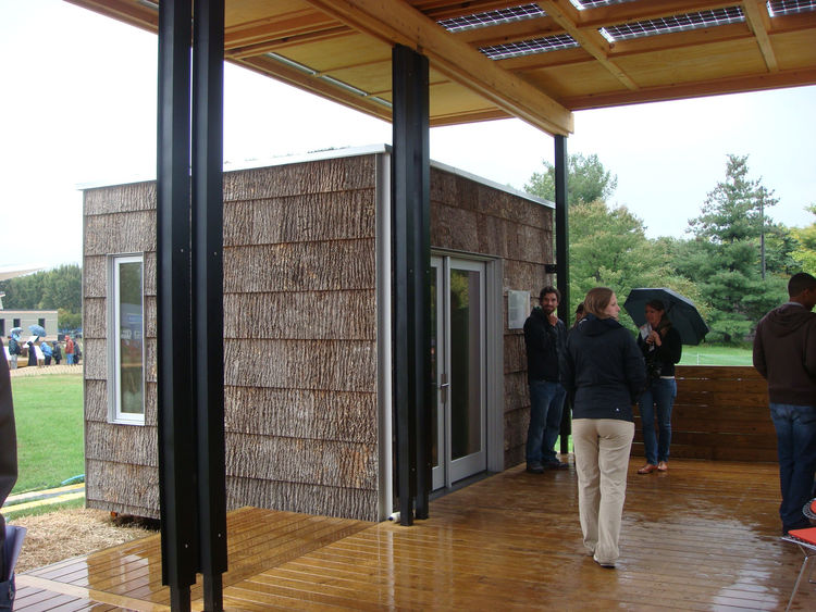 The home consists of one main building and three outbuildings that can be configured in many different ways. This outbuilding clad in poplar bark is an office. The poplar bark shingles are maintenance-free for up to 80 years and are a Cradle to Cradle gol