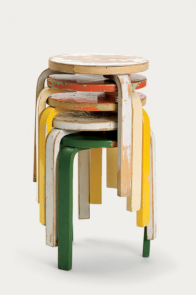A stack of painted and worn Stool 60s, perhaps one of the most popular pieces from Artek's archive, given new life in the 2nd Cycle series.