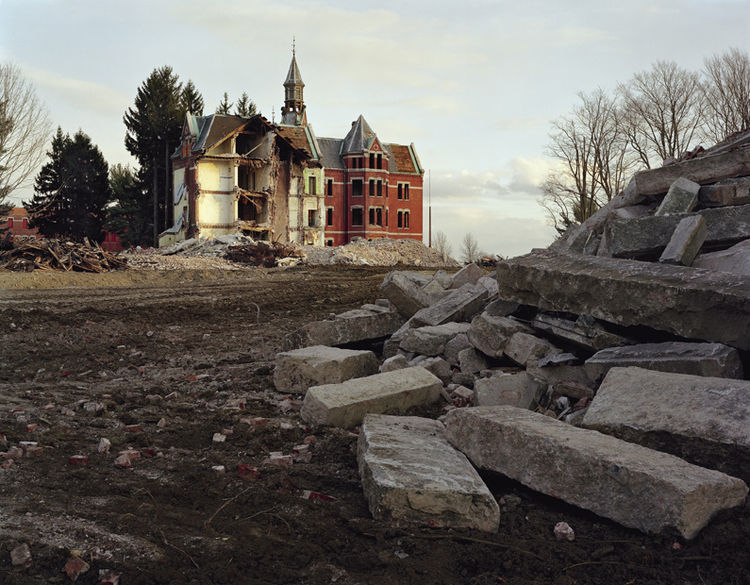 This photo shows the demolition of the Danvers State Hospital in Danvers, Massachusetts.