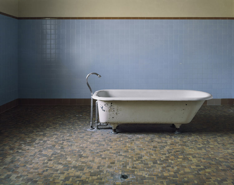 This lone bathtub against a sea of tile was used by patients at Fairfield State Hospital in Newtown, Connecticut.