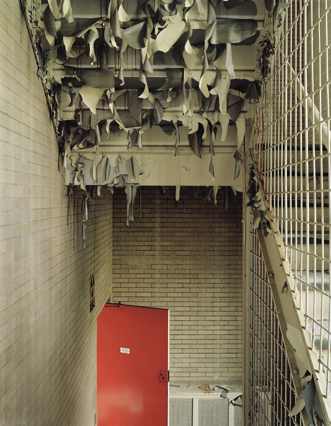Paint coming off the bottom of this staircase makes an abstract sculpture at Harlem Valley State Hospital in Wingdale, New York.