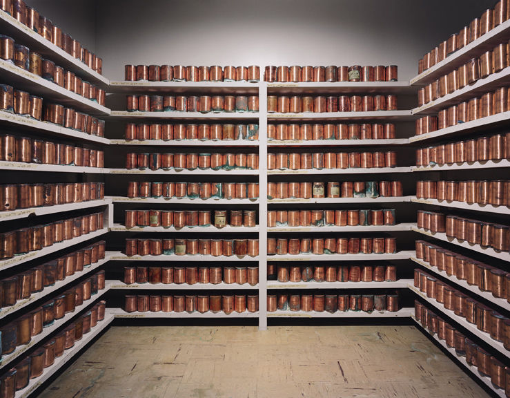 Unclaimed copper cremation urns line the walls of a storeroom in the Oregon State Hospital in Salem.
