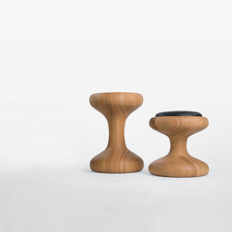 The design of the Mushroom family of stools was function driven: They can  be seats or tables.