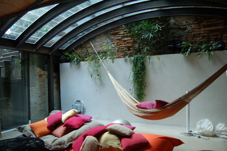 By this time, after an amazing meal of fresh seafood and other Catalan delicacies, my sleep-deprived brain was begging for a nap. This cozy hammock space, underneath a graceful glass canopy, was beckoning to me. I resisted, but barely.
