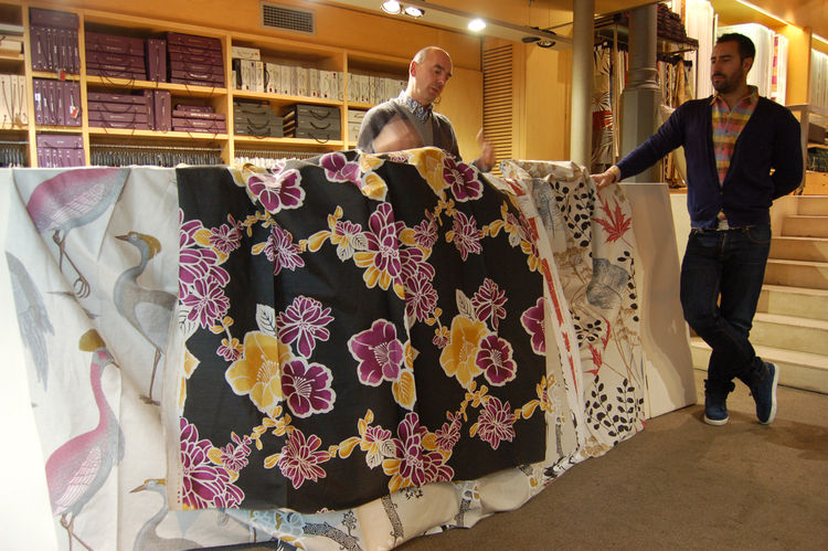 We watched as Garabieta unfurled a few of his favorite designs from the archives. The one featured here with the purple flowers in called Sintra, and it's inspired by Japanese kimono designs.