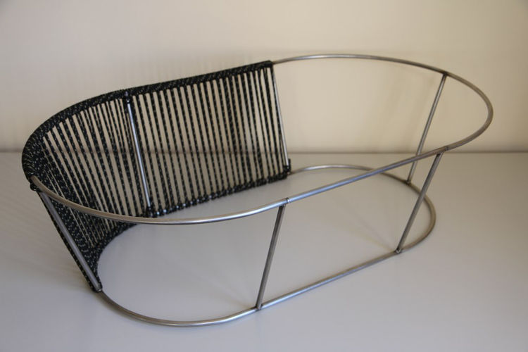"""""""The construction follows the main form and is made from a frame that is the base for a weave. I thought of the following when selecting materials: The frame needs to be durable and long lasting to stay true to the argument above. The weave needs to feel"""