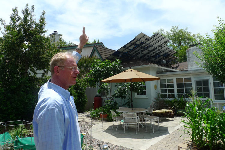 Begley demonstrates how his solar panels are angled to take full advantage of the sun's path.